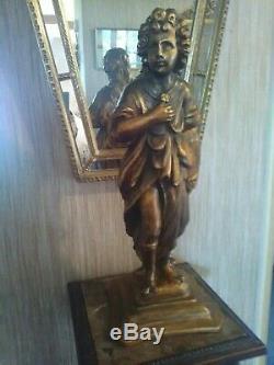 Golden Carved Wooden Statuette