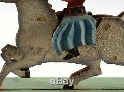 TRES ANCIEN JOUET A BALANCIER, tôle peinte, cheval et cavalier, XIXème, 27 cm